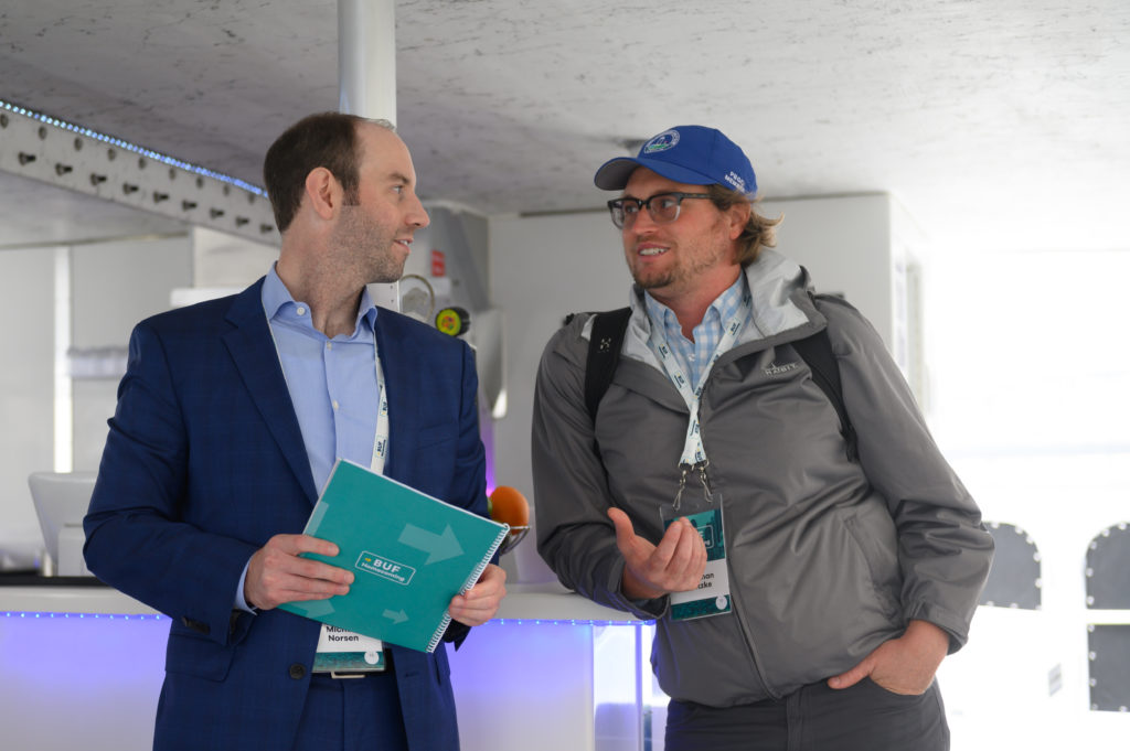 Jonathan Fentzke, right, networks with Michael Norsen during the waterfront tour at Buffalo Homecoming 2019. (IMAGE: Joed Viera, Buffalo Business First)
